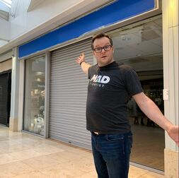 Alan Donegan outside an empty retail unit