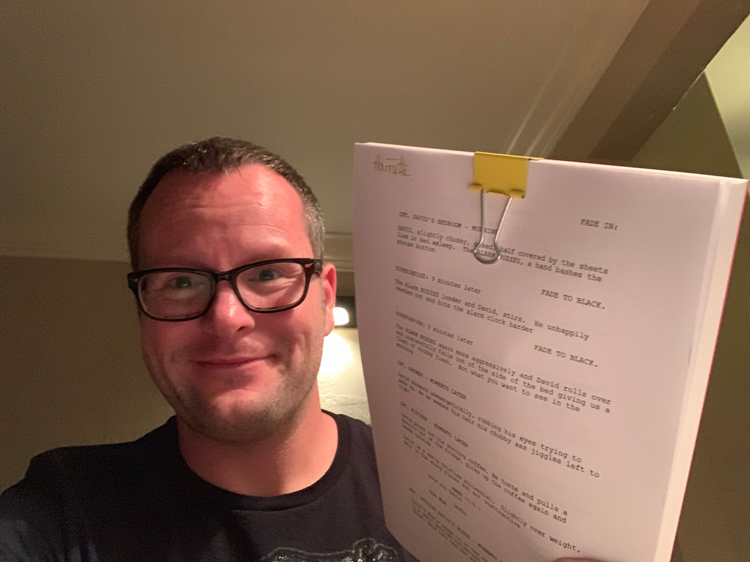 Alan Donegan holding up his finsihed script